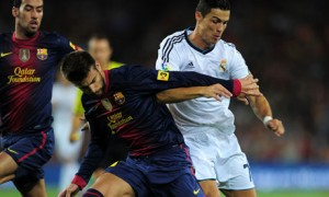 ronaldo tangles with pique and busquets
