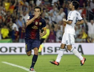 xavi scores against madrid in the super cup 2012