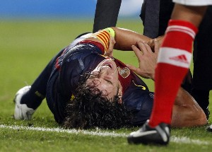 puyol dislocates left elbow