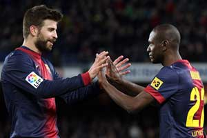 Abidal and Pique