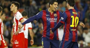 messi celebrates with suarez against almeria
